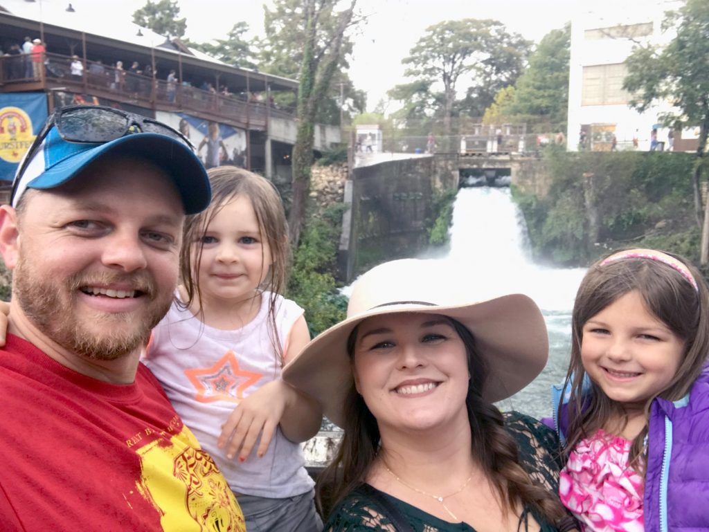 A family in front of a river